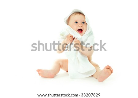 happy cute baby wrapped into the white towel - stock photo