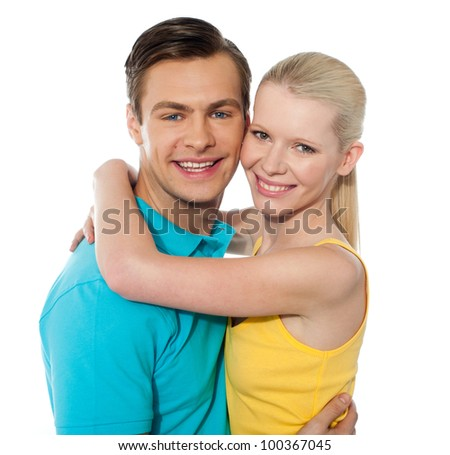 Happy cute couple hugging in front of camera camera