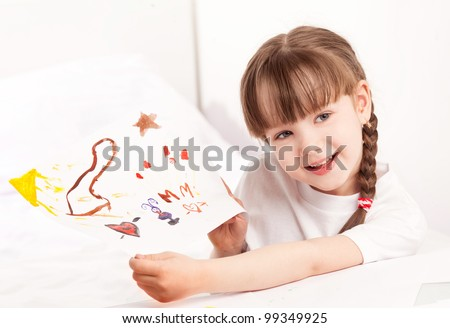 happy cute five year old girl painting with watercolor at home and showing us the picture - stock photo