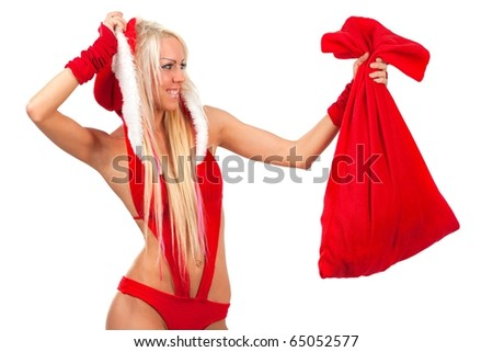 Happy cute girl in santa claus suit with gift bag over white - stock photo