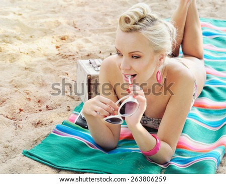 happy cute hot body young woman lying on the beach with colorful details, relax concept, travel   - stock photo