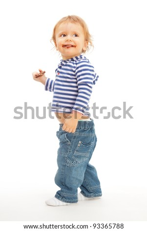 Happy cute kid with chocolate walking and smiling - stock photo