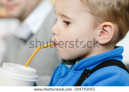 Happy cute kid with drinking straw closeup portrait - stock photo
