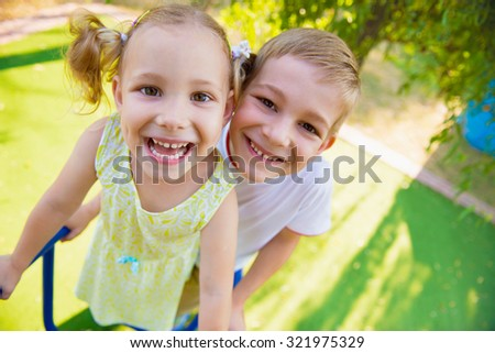 Happy cute kids having fun at playground