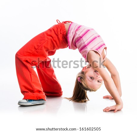happy cute little girl goes in for sports on a white - stock photo