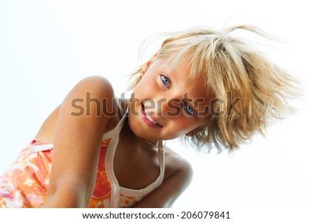Happy Cute Little Girl having fun outdoor. Joyful teen girl laughing - stock photo