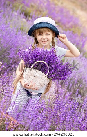 Happy cute little girl is in a lavender field - stock photo