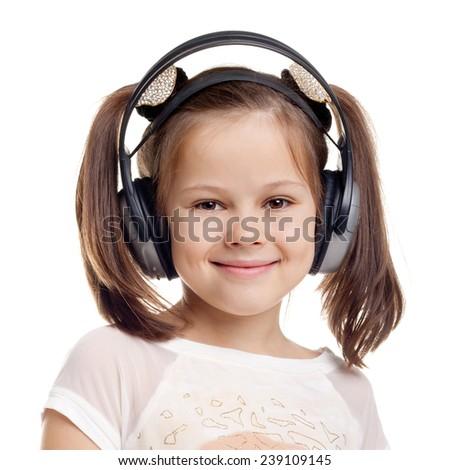 happy cute little girl wearing the headphones - stock photo