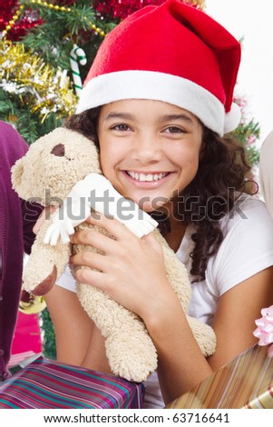 happy cute little girl with presents near a christmas tree - stock photo