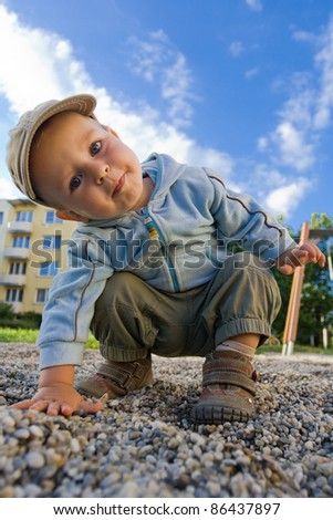 Happy cute young boy playing on the playground - stock photo