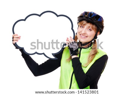 Happy cyclist girl in helmet and green vest holding the blank board as speaking bubble - stock photo