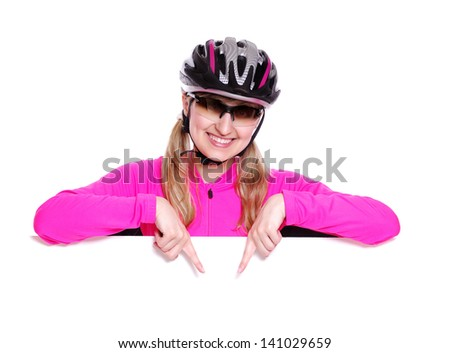 happy cyclist girl in sun glasses and a  helmet  showing to the horizontal blank board on white background closeup - stock photo