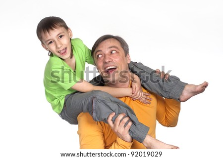 happy dad and  his son standing on a white background