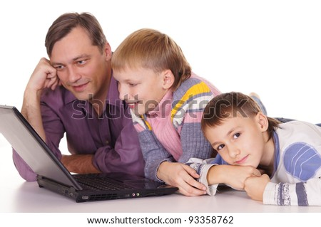 happy dad and his sons at computer