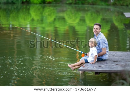 Happy dad and son fishing