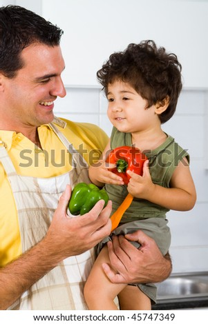 happy dad and son in kitchen - stock photo