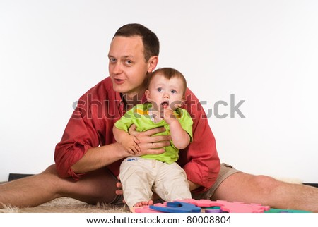 happy dad and son play on a white