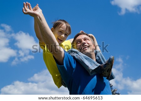 happy dad with son in a park - stock photo