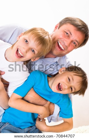 happy dad with two children on a white background - stock photo