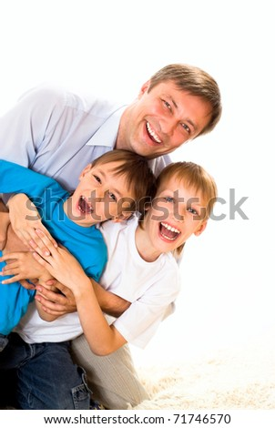 happy dad with two children on a white background