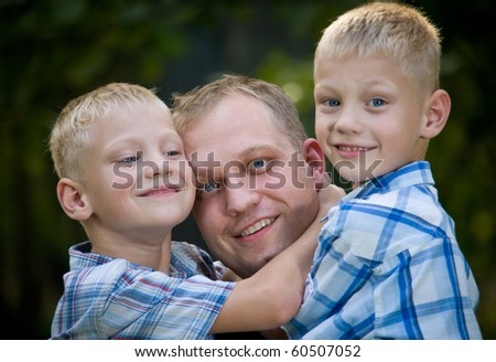 Happy dad with two twin boys portrait - stock photo