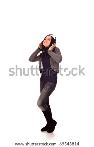 happy dancing girl is listening to music