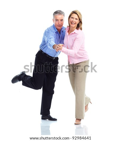 Happy dancing senior couple in love. Isolated over white background. - stock photo