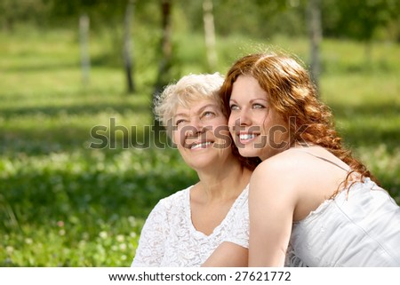 Happy daughter and mother in a summer garden - stock photo