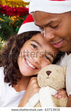 happy daughter hugging daddy with Christmas gift - stock photo