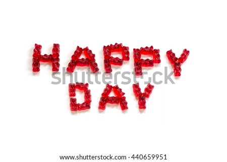 Happy Day, letters made from red gummy bears on a white background - stock photo