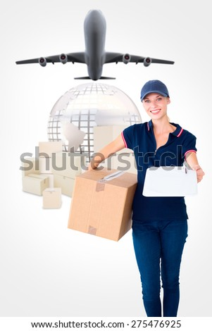 Happy delivery woman holding cardboard box and clipboard against logistics concept - stock photo