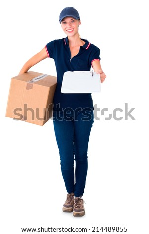 Happy delivery woman holding cardboard box and clipboard on white background - stock photo