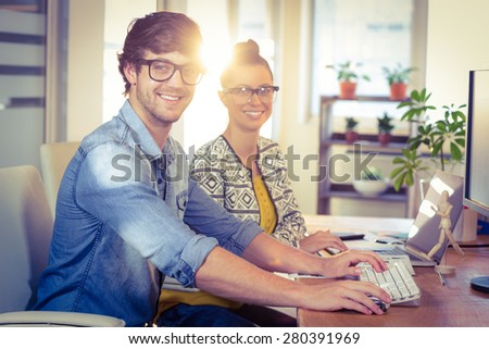 Happy designers working together in creative office - stock photo