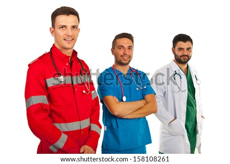 Happy different doctors standing in a row isolated on white background