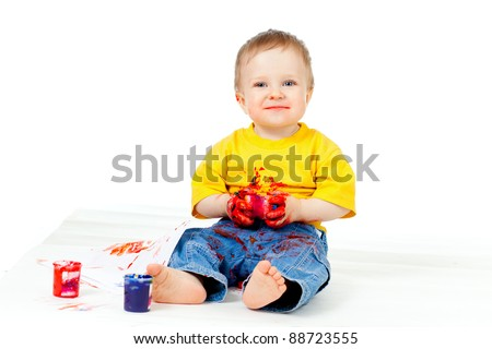 Happy dirty child with paints - stock photo
