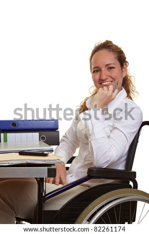Happy disabled business woman at work on her desk