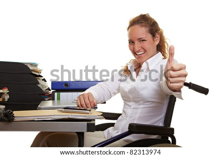 Happy disabled business woman in wheelchair holding thumbs up - stock photo