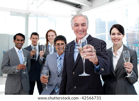 Happy diverse business group toasting with Champagne to celebrate a succes - stock photo