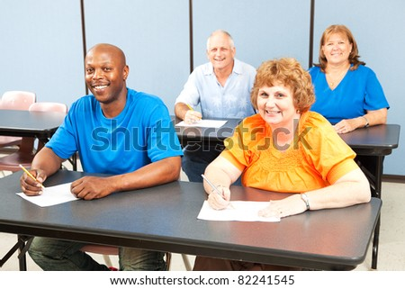 Happy, diverse group of adult education students in class. - stock photo