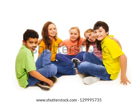 Happy diversity looking kids, boys and girls in semi-circle, smiling, hugging, on white - stock photo