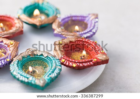 Happy Diwali. Colorful clay diya lamps lit during diwali celebration. With copy space - stock photo