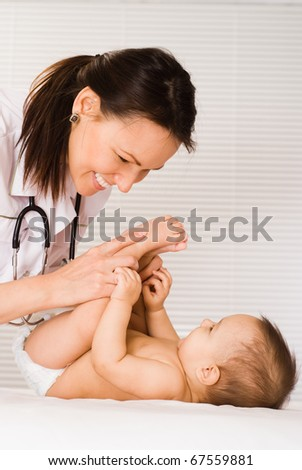 happy doctor and newborn on a white background