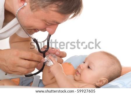 happy doctor examining newborn - stock photo