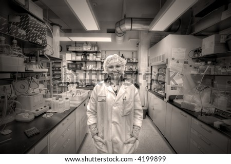 Happy Doctor - female worker in lab of biology industry - stock photo