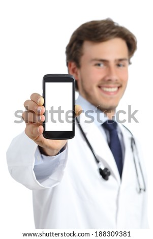 Happy doctor man showing a blank smart phone screen isolated on a white background             - stock photo