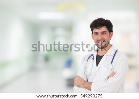 happy doctor with an operating room at the background