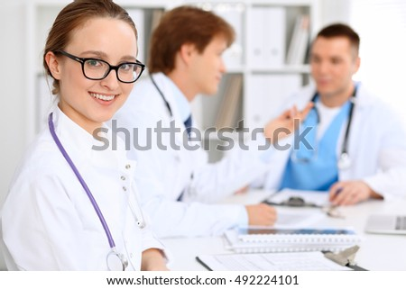 Happy doctor woman  with medical staff at the hospital