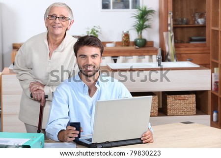 Happy doing accounting at home - stock photo