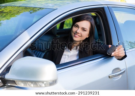 happy driver business woman showing new car keys and car - stock photo