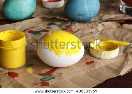 Happy easter! A happy family is getting ready for Easter. painting Easter eggs. Top view, closeup,